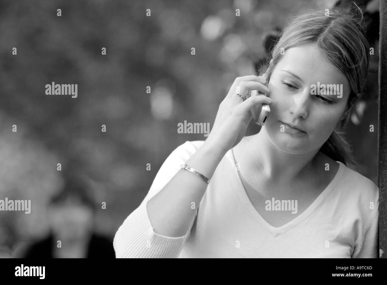 teenage girl on mobile phone student teen speak talk text txt coms communication telecoms telecommunication handset pay as you g - Stock Image
