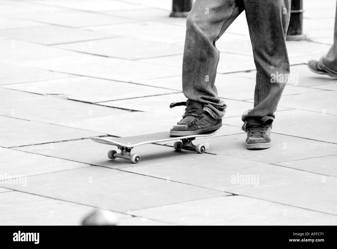 skate boarding skate board grind youth culture fashion jackass injury extreme sport trend teenage male interest - Stock Image