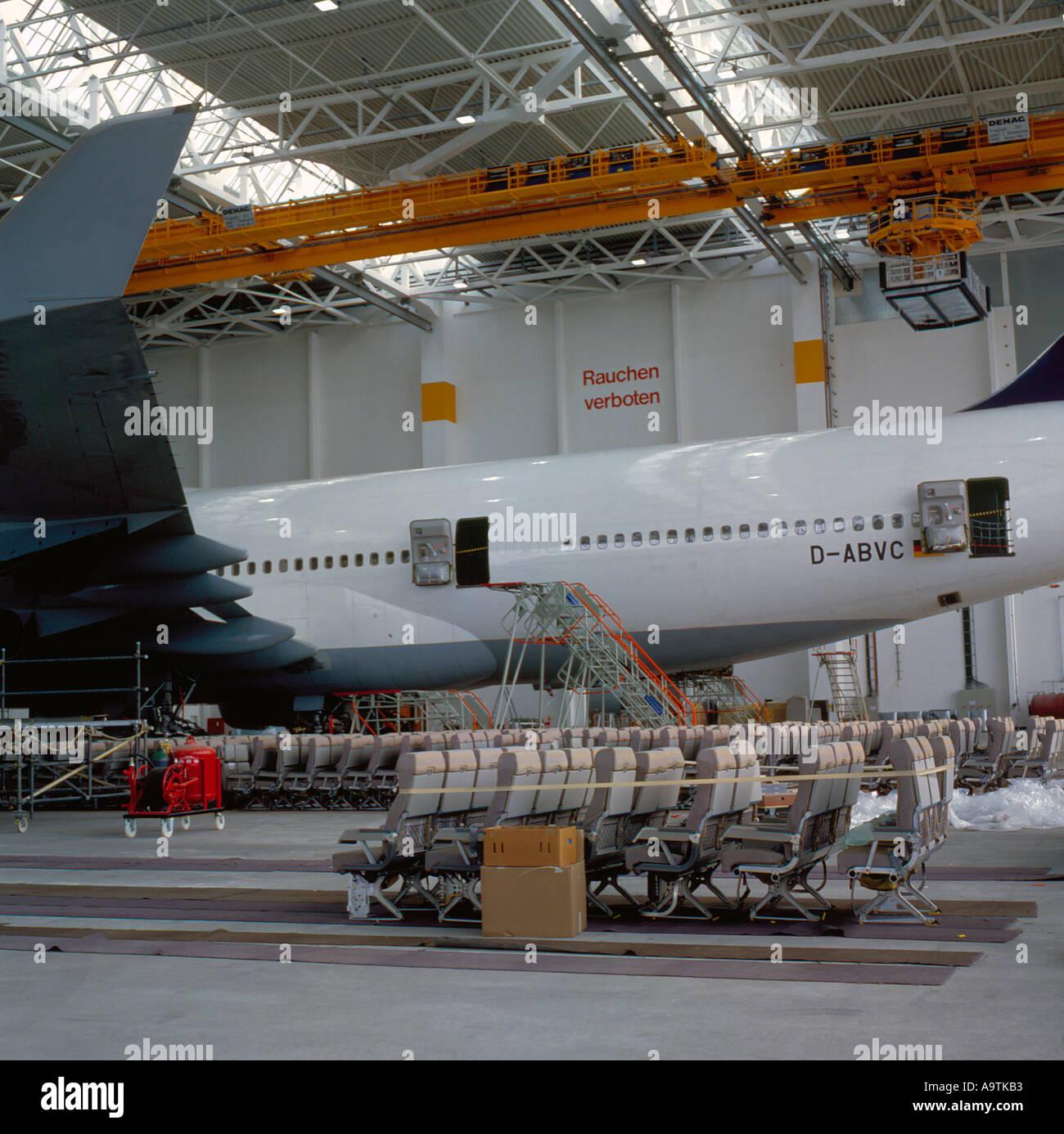 Lufthansa Boeing 747-430 in Hangar at Franz Josef Strauss International Airport Munich  Bavaria Germany. Photo by Stock Photo
