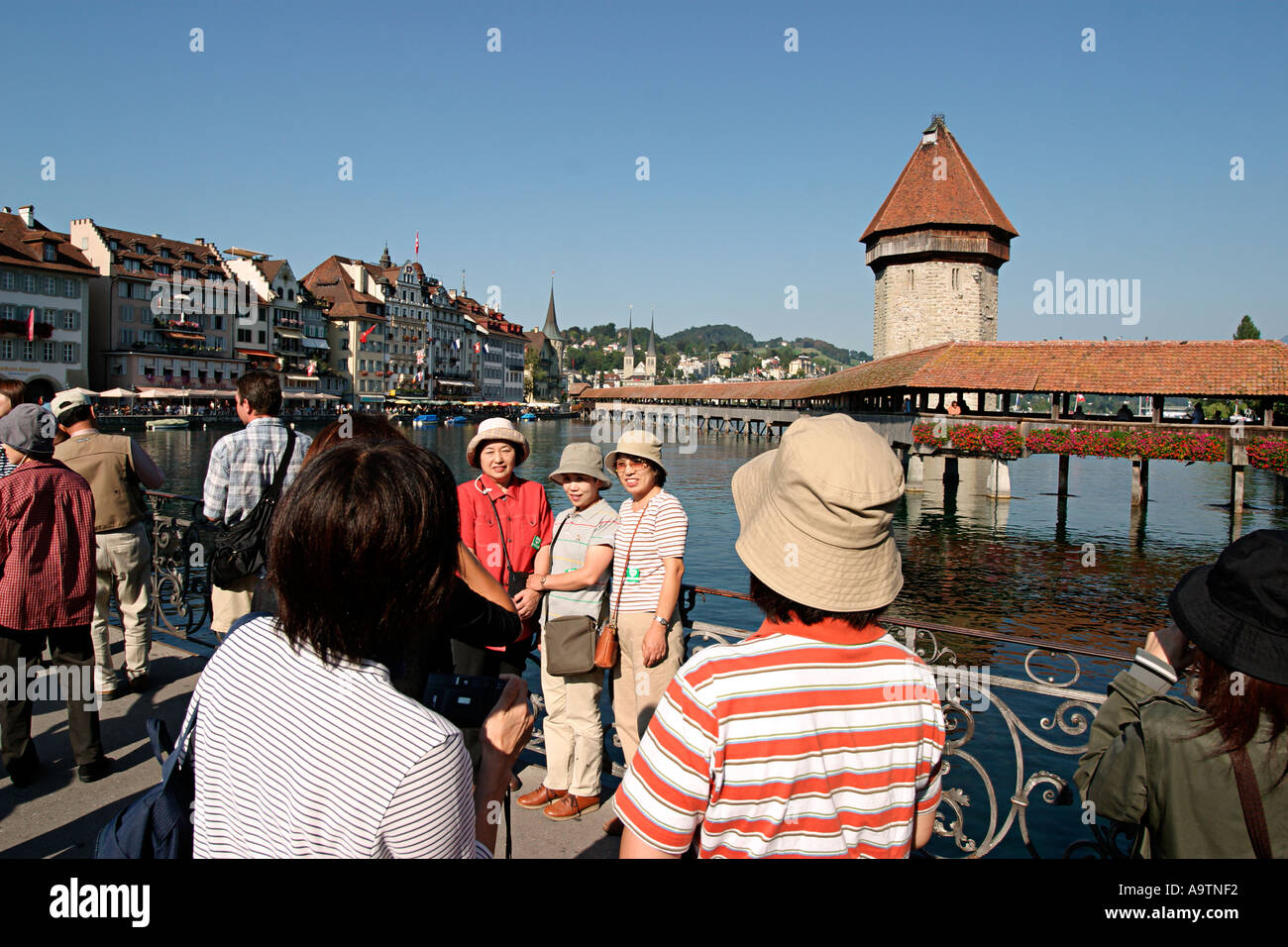 switzerland Lucerne chapell bridge japanese tourists - Stock Image