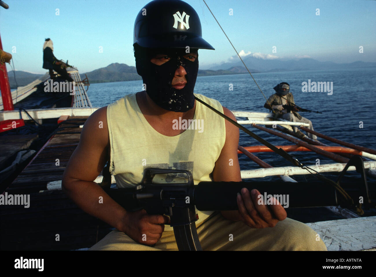 Pirate Tony keeps a look-out, armed with an M16. - Stock Image