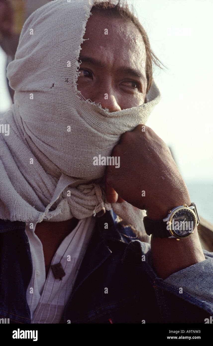 Ronnie, captain of a pirate crew of a 22 meter outrigger boat wearing a watch he stole on a raid - Stock Image