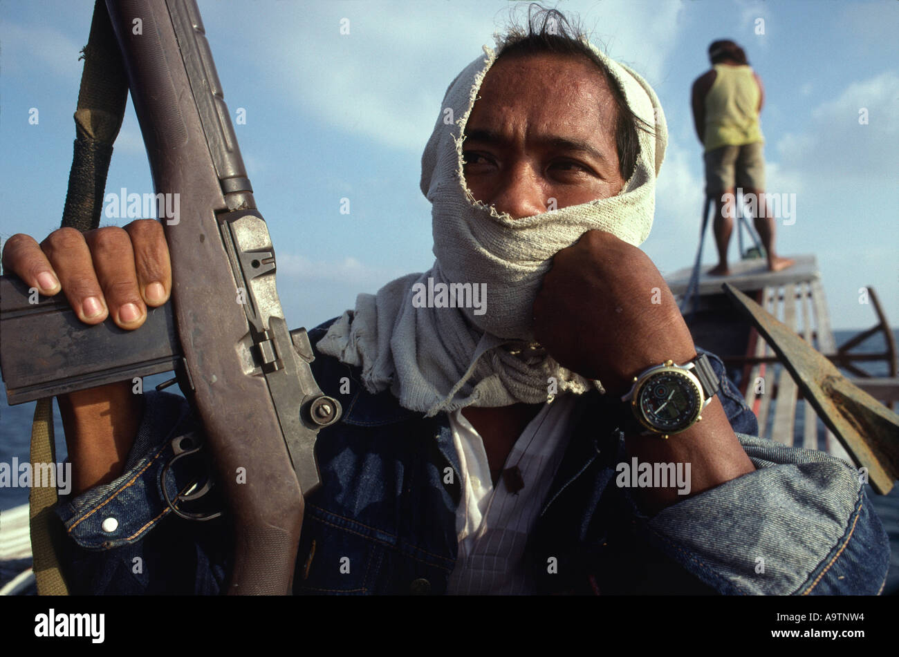 Pirate Captain Ronnie wears a watch he stole on a raid. He operates in the south China Seas with his crew of 5. - Stock Image
