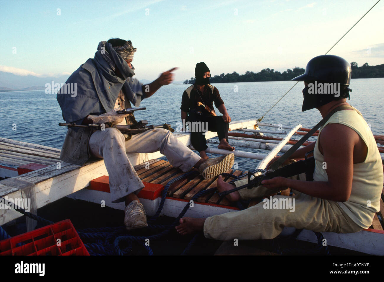 Pirates on board their 22 meter outrigger boat - Stock Image