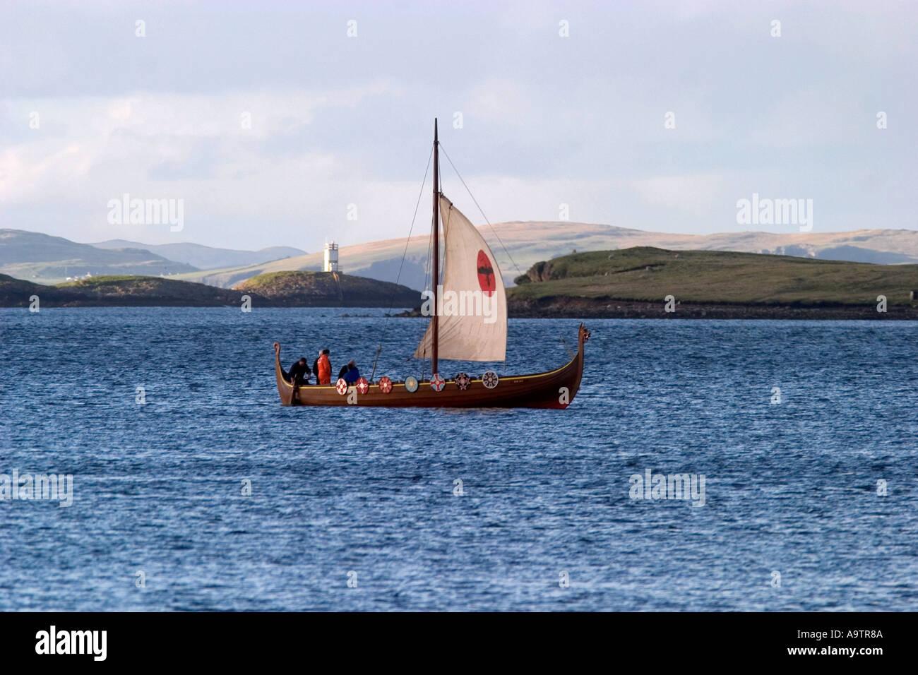 viking longship sailing across lerwick harbor - Stock Image