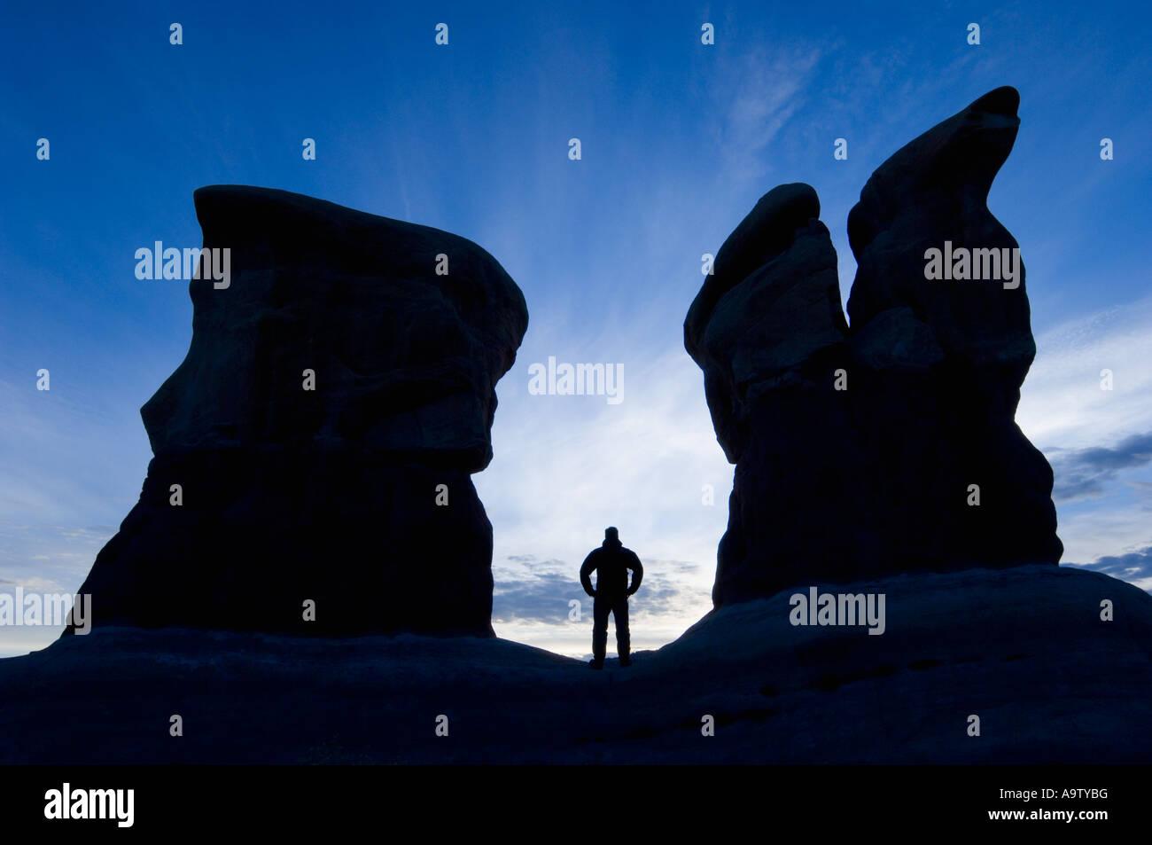 Man standing between two sandstone features in Devil's Garden Utah Stock Photo