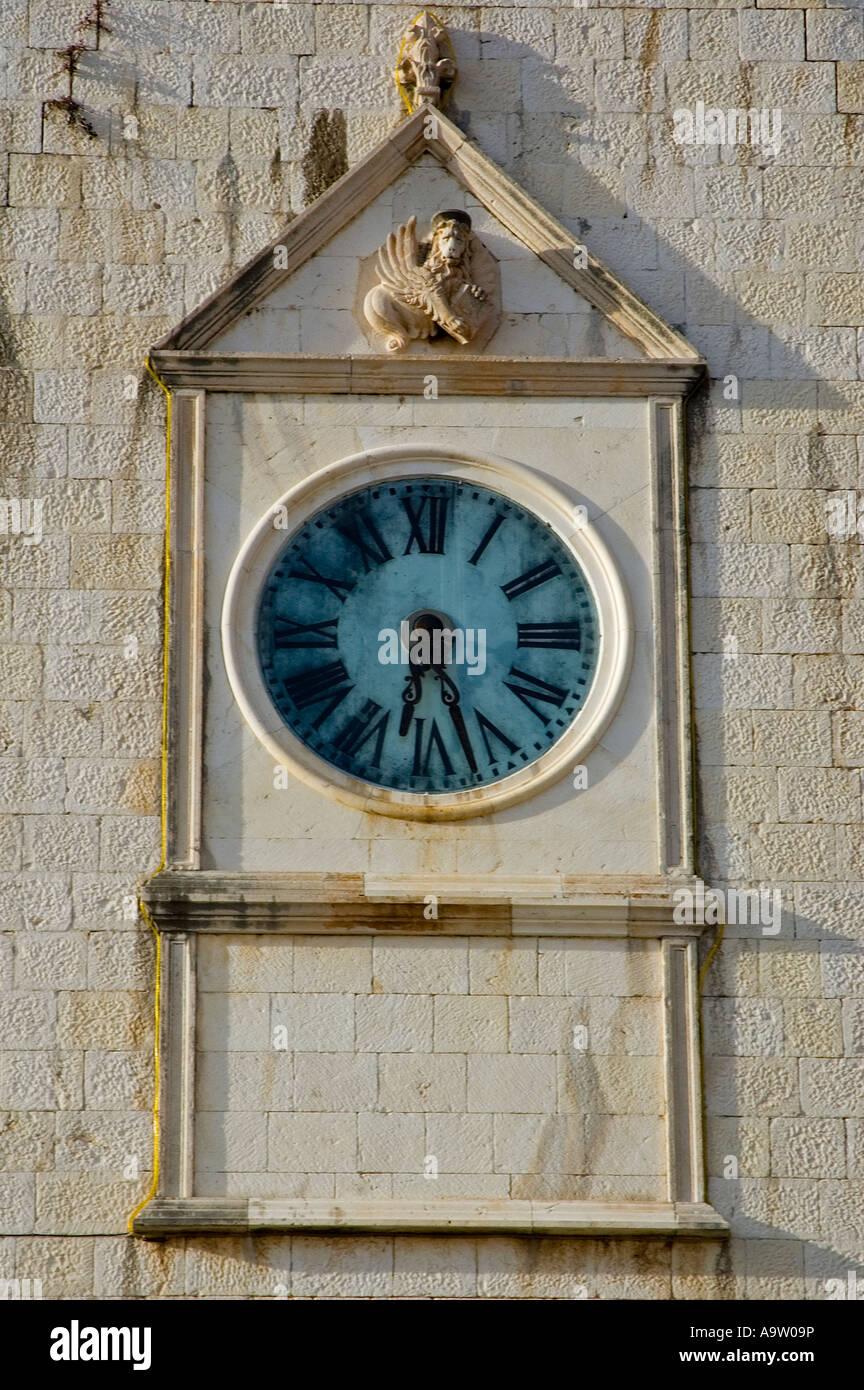 Clock on a historical building, Hvar Old Town, Croatia. - Stock Image