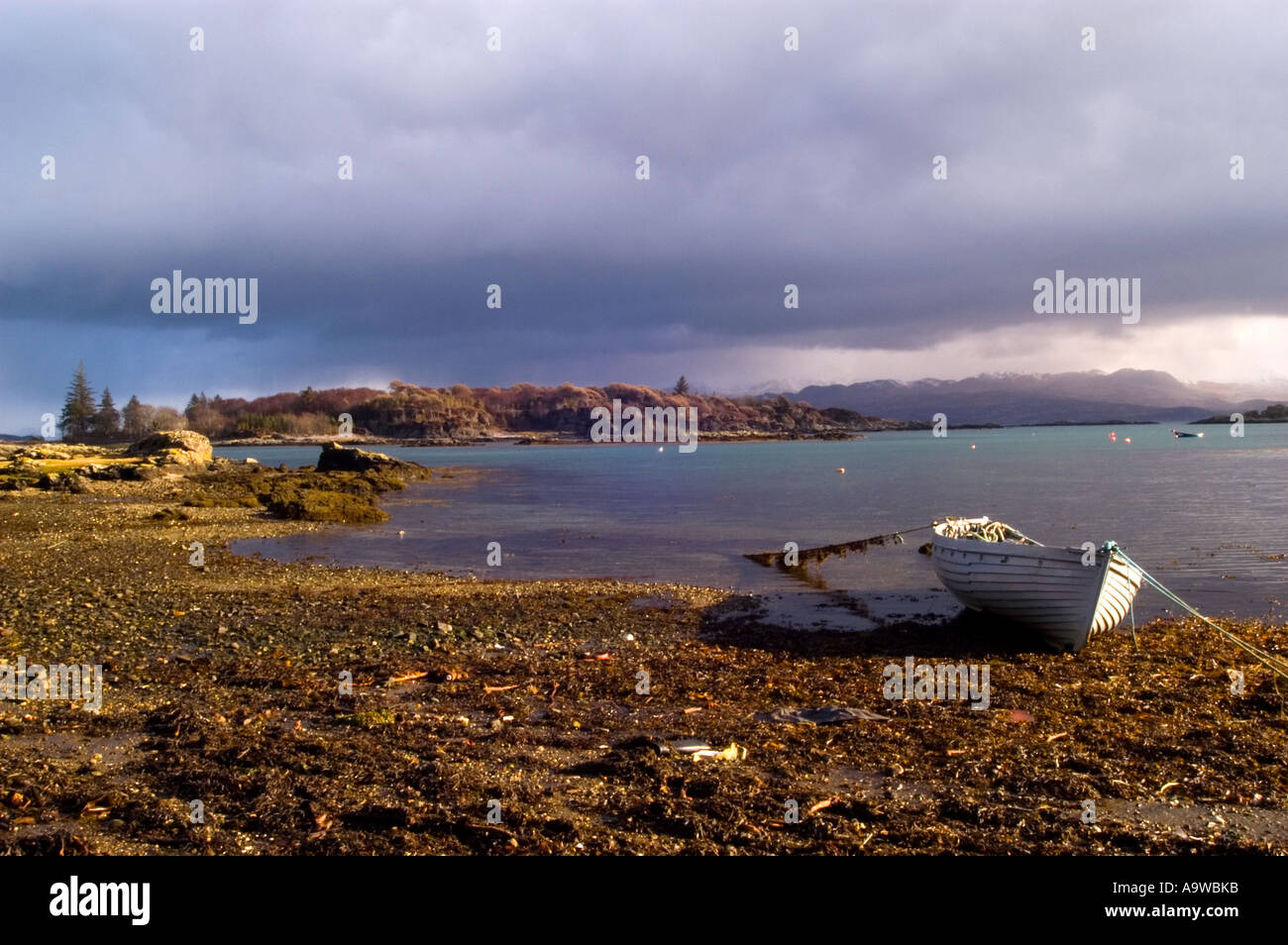 White rowing boat on the shore of  Armadale Bay on the Isle of Skye, Scotland, UK - Stock Image