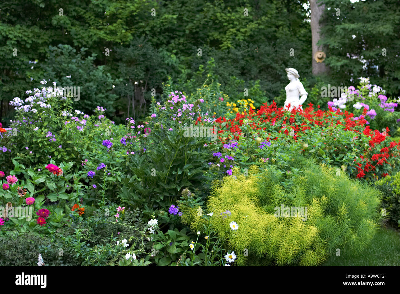 WISCONSIN Lake Geneva Lush Private Garden Of Lakefront Home Garden Statue  Of Young Women Amid Flowers