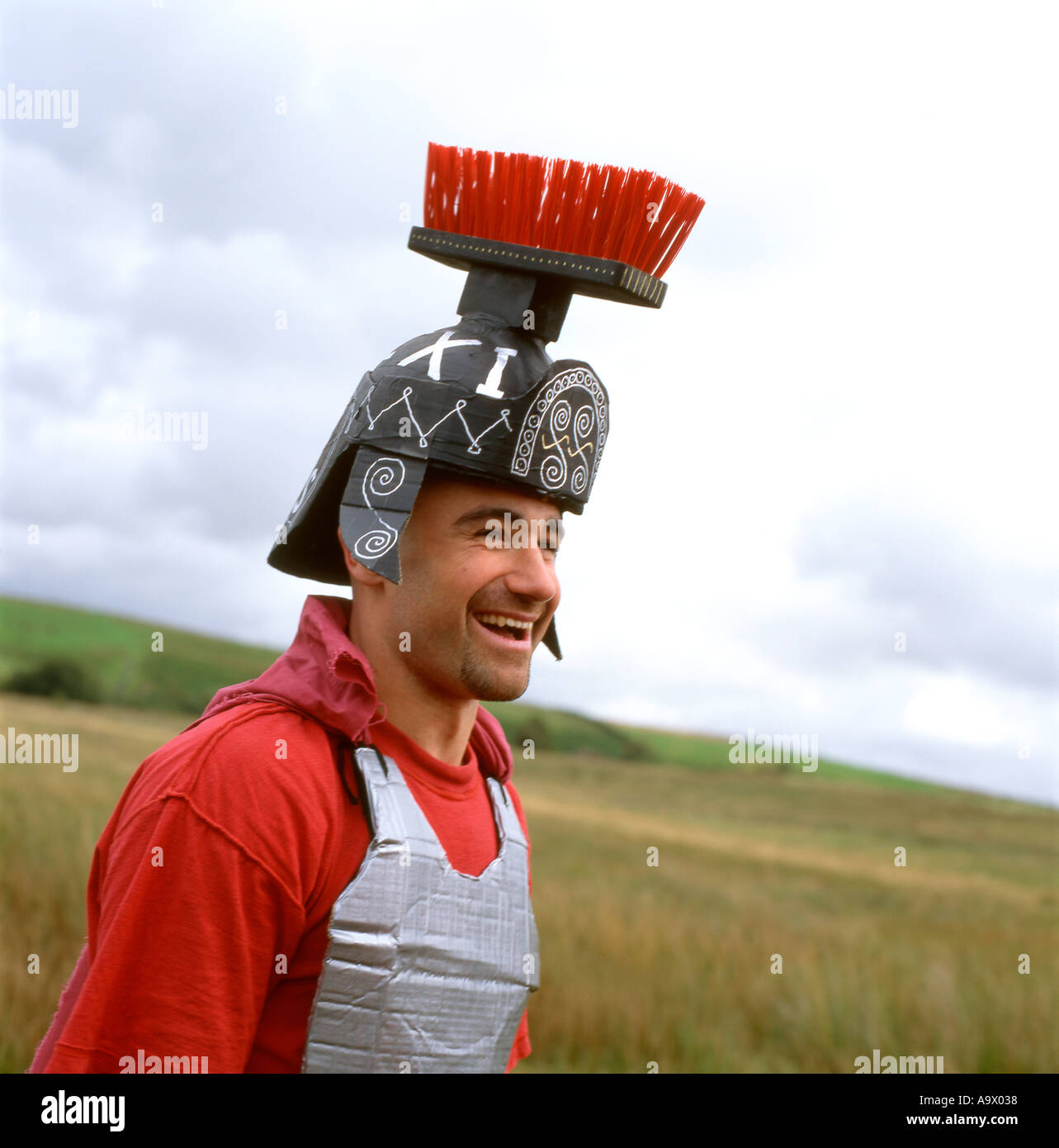 A Roman Centurion soldier in fancy dress with broom helmet at the World Bog Snorkelling Championships in Llanwrtyd Wells Powys Wales UK KATHY DEWITT - Stock Image