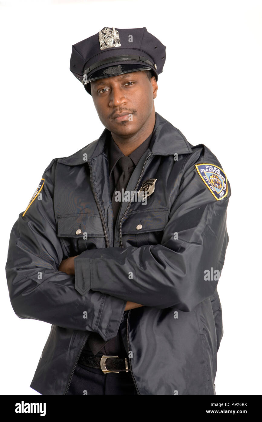 Young Black Police Officer Looking At The Camera In The