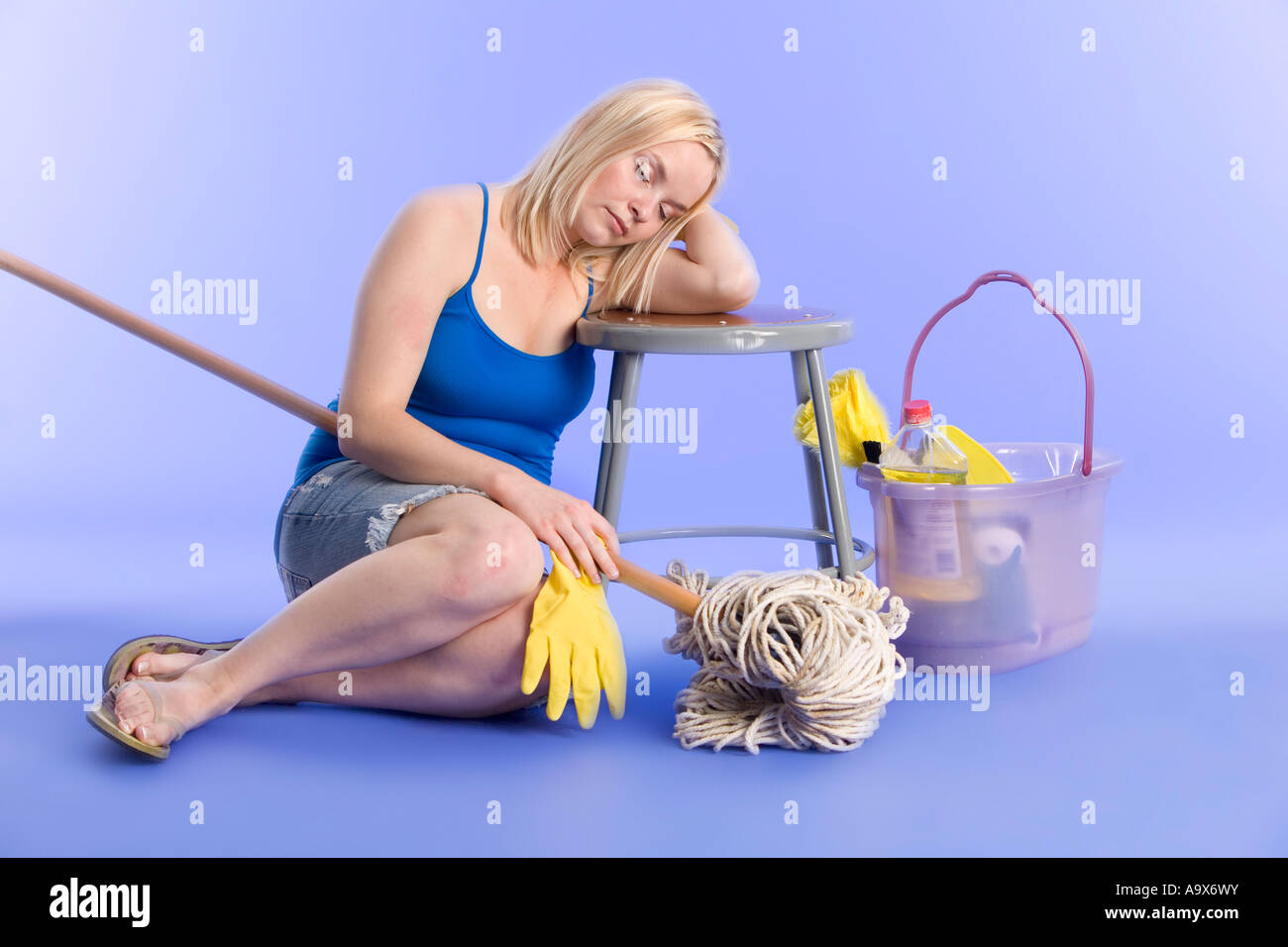 woman tired and sleeping after household chores and cleaning - Stock Image