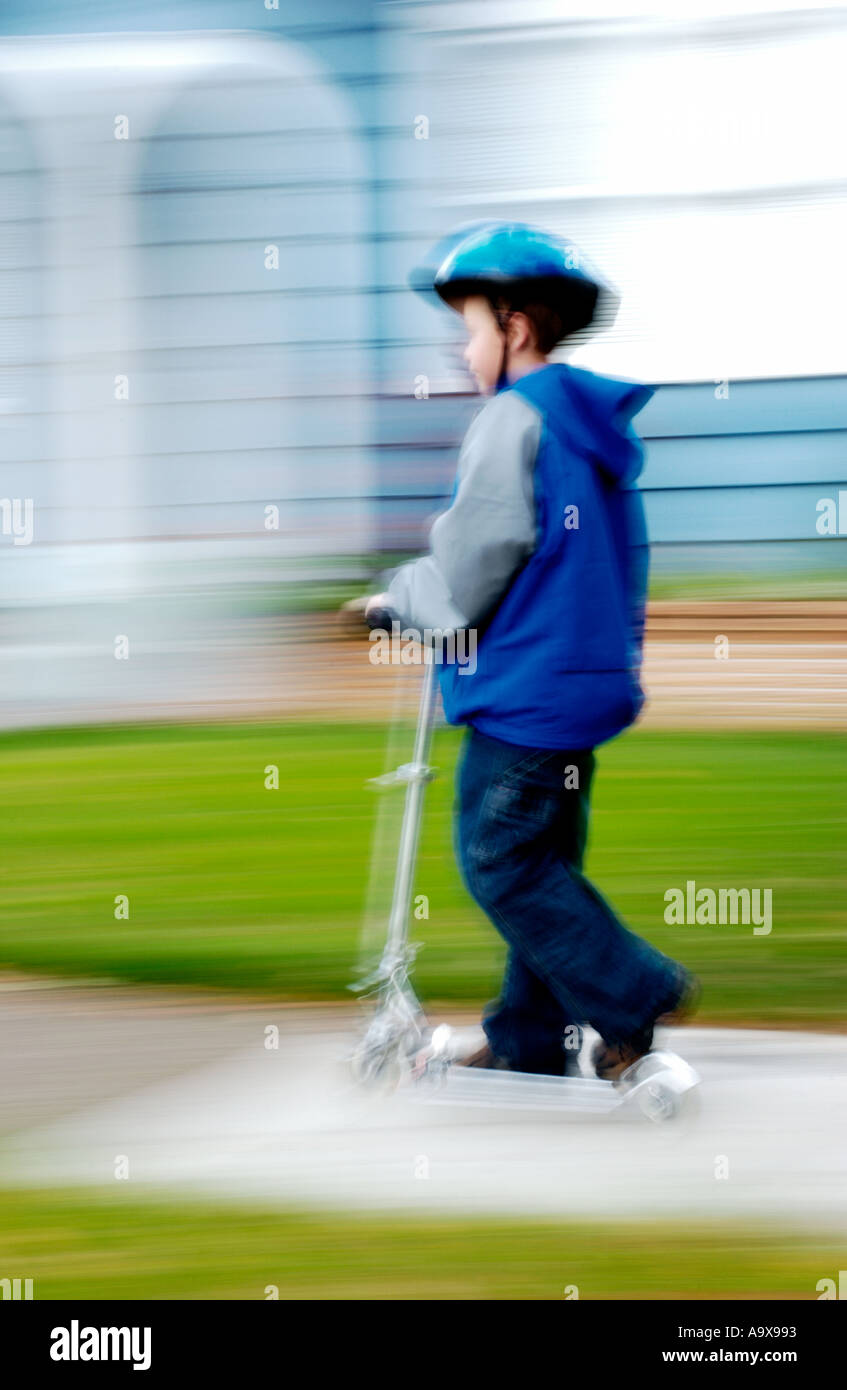 boy riding scooter - Stock Image