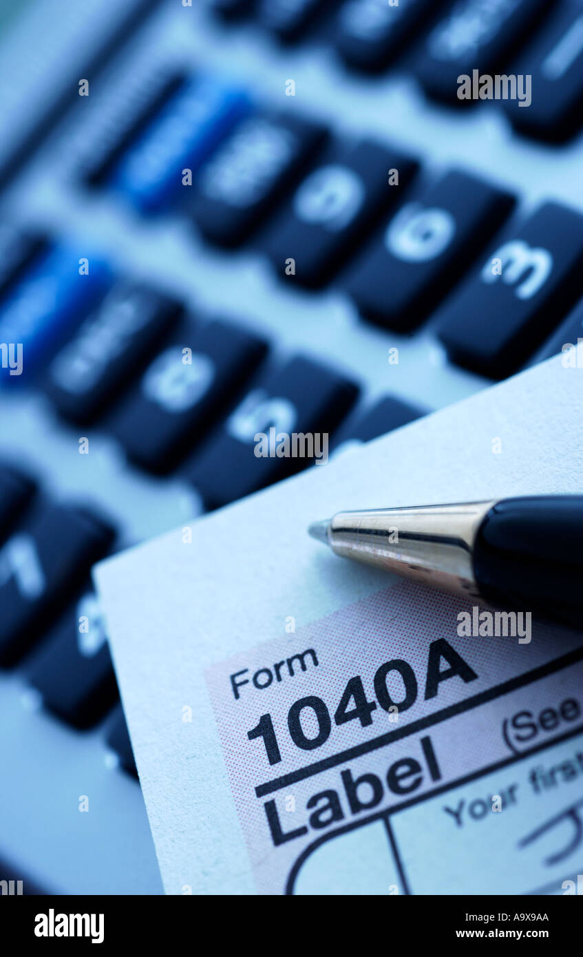 IRS Income Tax with calculator and pen - Stock Image