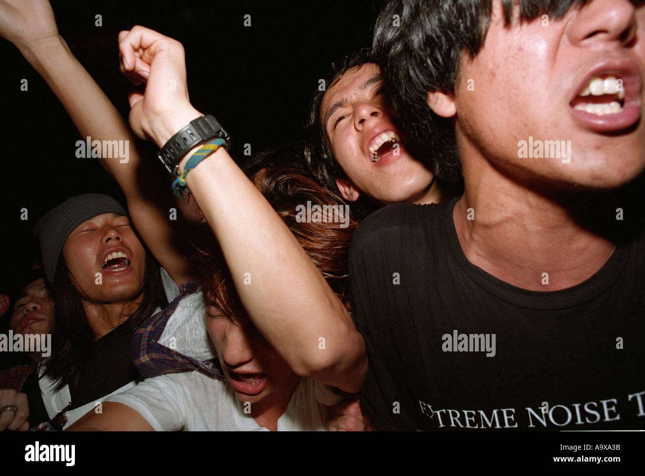 Young Japanese at a rock concert in Tokyo - Stock Image