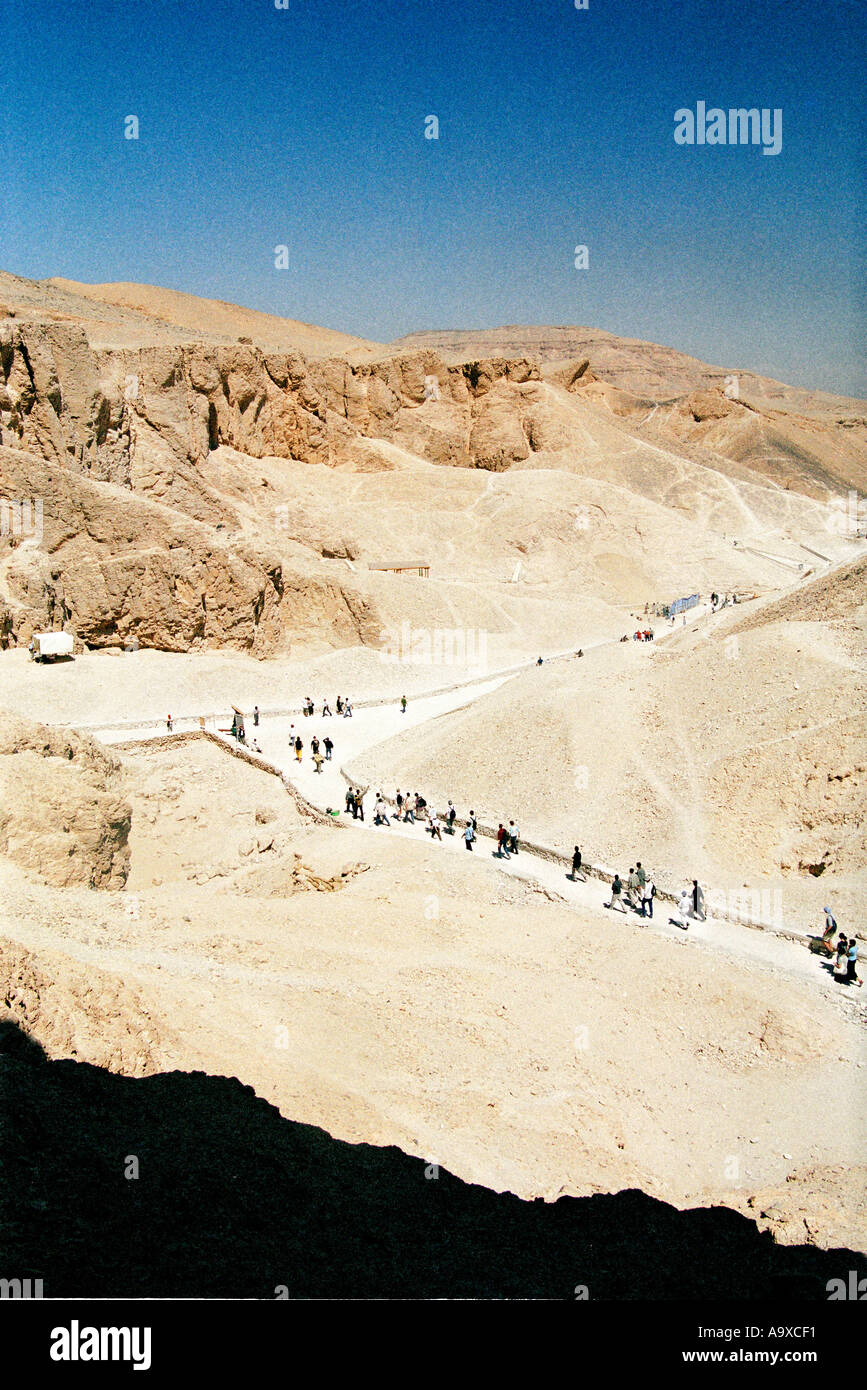 Tourists walking through the Valley of the Kings in Luxor Egypt Stock Photo