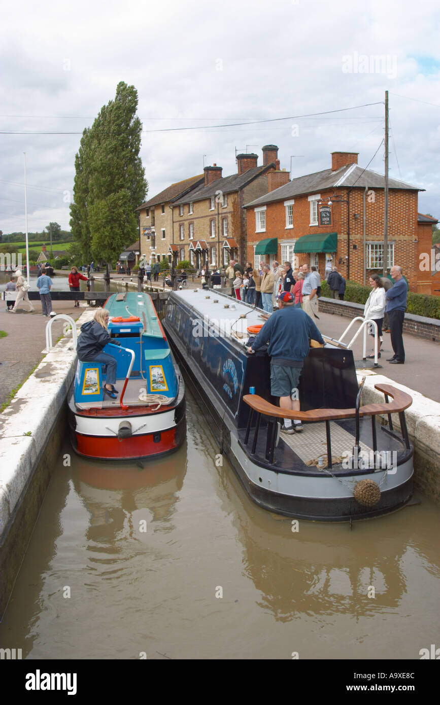 Two boats inside the locks at Stoke Bruerne on the Grand Union Canal England - Stock Image