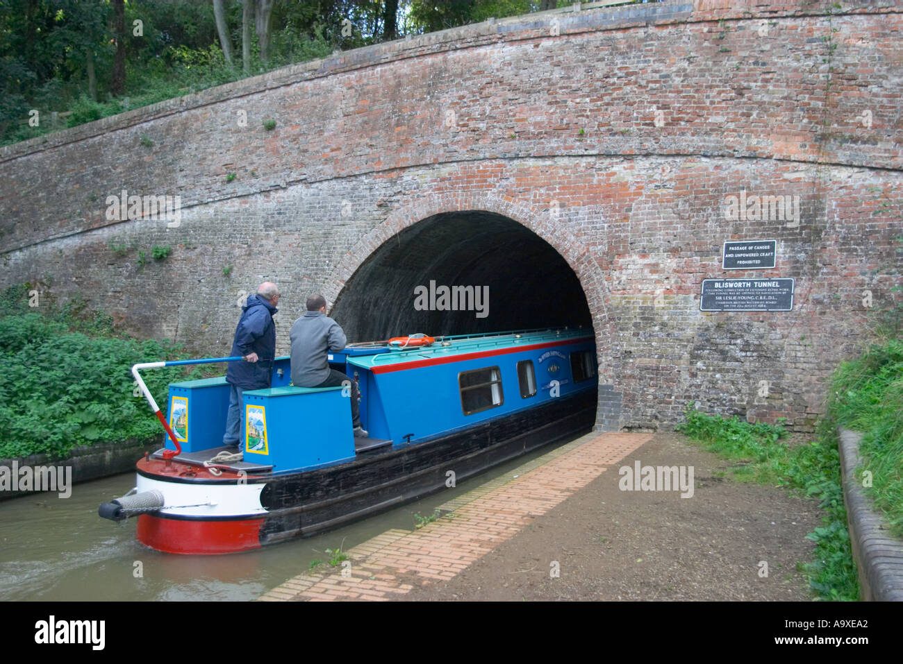 A boat going into the entrance of Blisworth Tunnel near Stoke Bruerne on the Grand Union Canal England - Stock Image