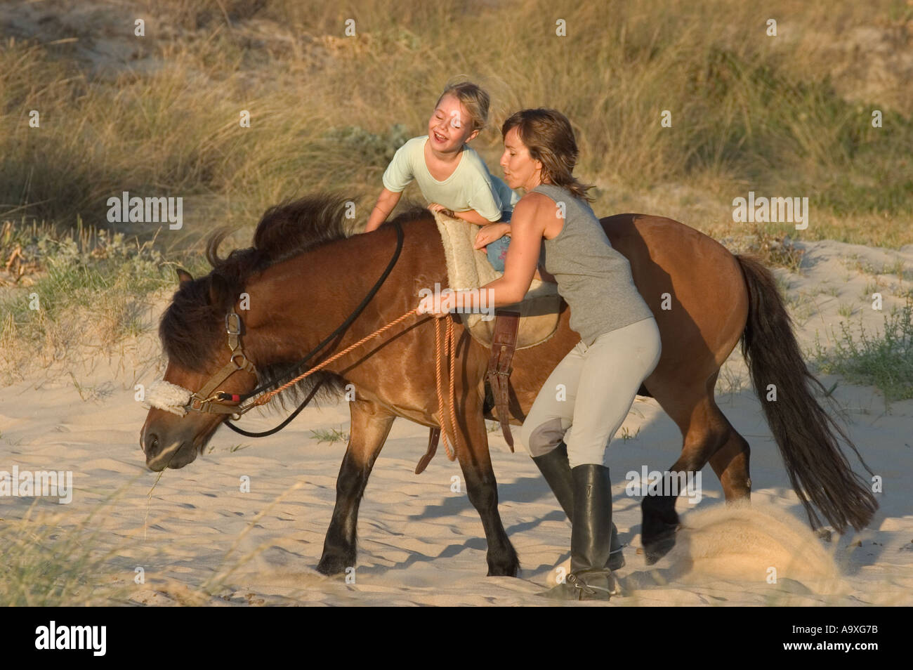 Mother And Daughter Horse Riding Outdoors Stock Photo Alamy