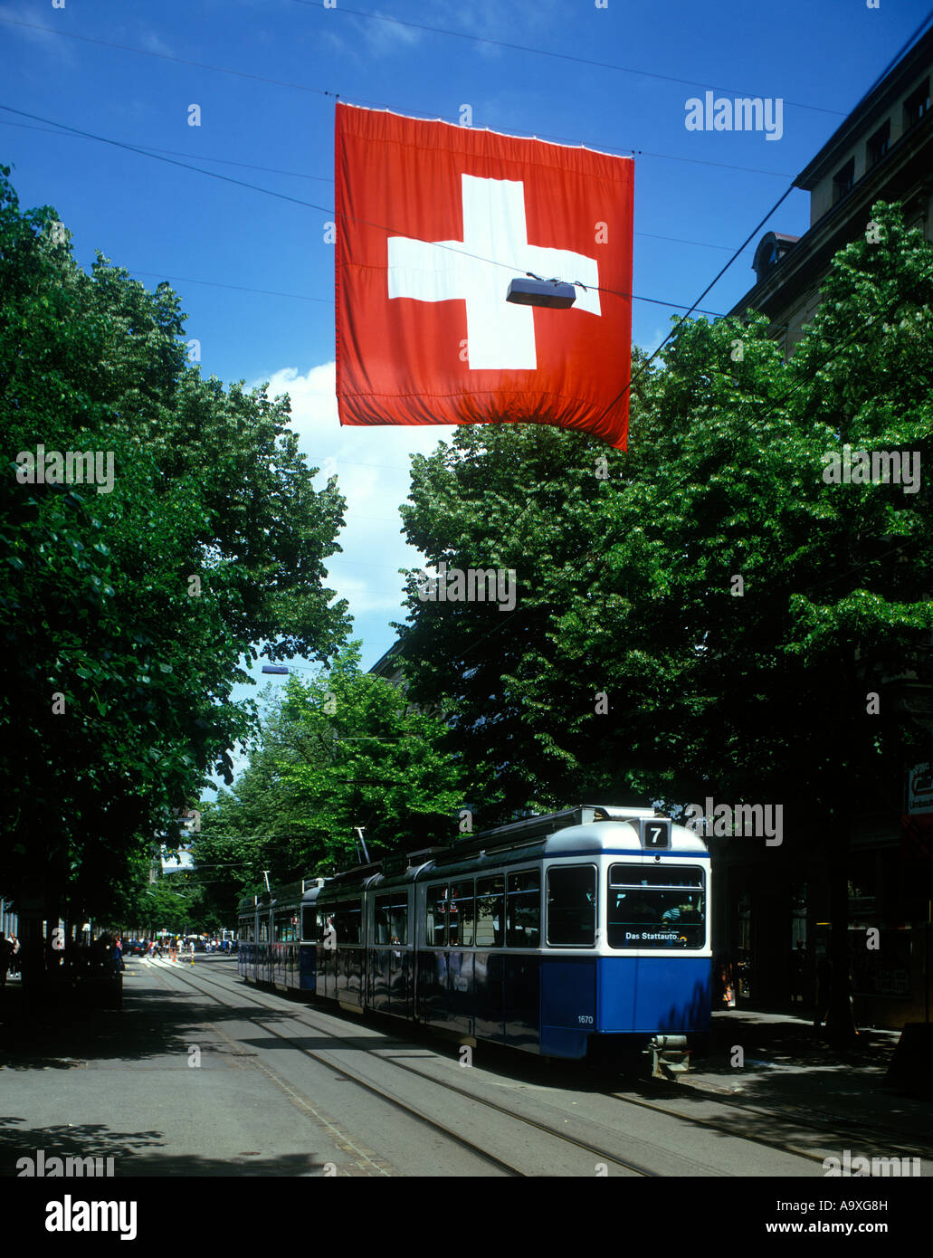 SWISS FLAG BAHNHOFSTRASSE ZURICH SWITZERLAND - Stock Image