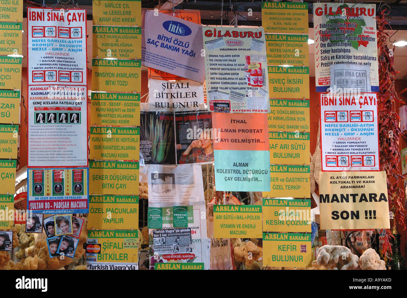 advertising leaflets hanging in a display at the spice market, Istanbul, Turkey - Stock Image