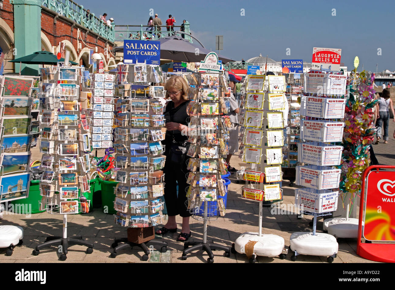 Seaside postcards for sale on promenade. Brighton, England - Stock Image