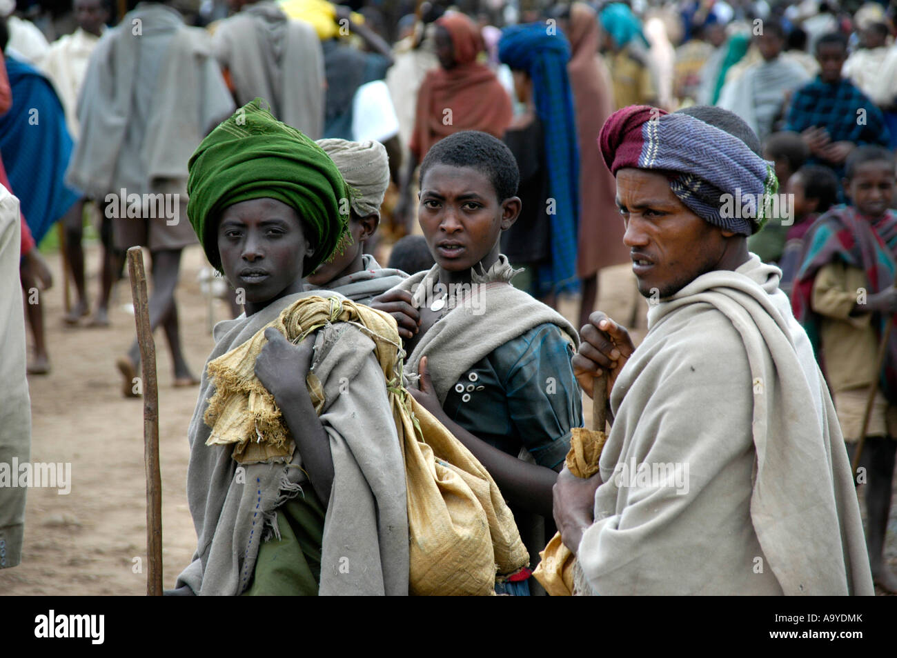 Three people in traditional dress on the market Bahir Dar Ethiopia Stock Photo