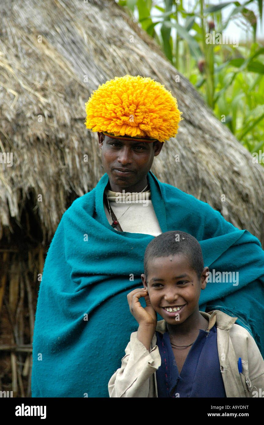 Student of a priest school with yellow hat near Bahir Dar Ethiopia - Stock Image