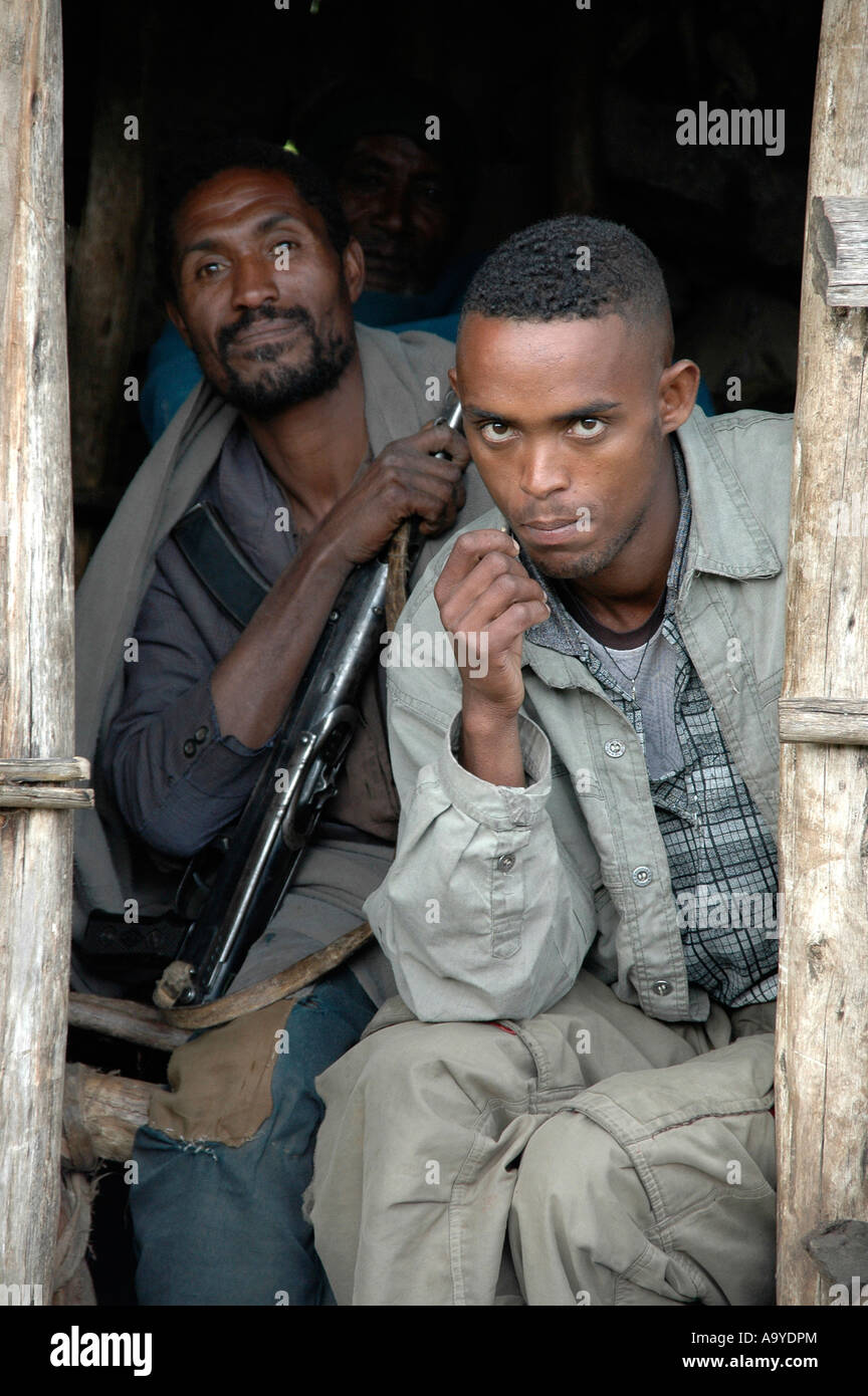 Two men with a rifle in a hut Ethiopia Stock Photo