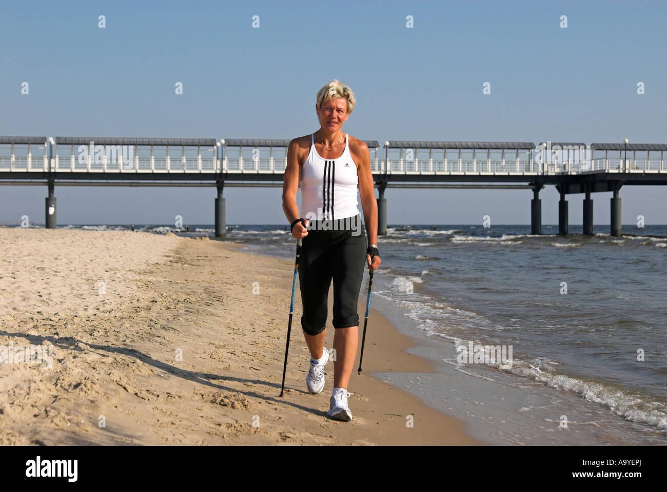 Personal trainer Sabine John at the beach of Heringsdorf, Usedom island, Mecklenburg Western Pomerania, Germany, Stock Photo