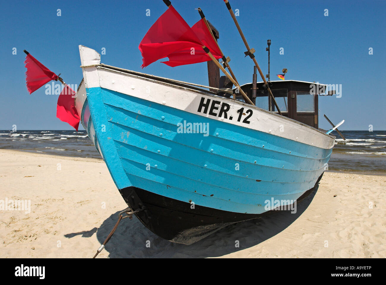 Fisher boat at the beach of Heringsdorf, Usedom island, Mecklenburg Western Pomerania, Germany, Europe - Stock Image