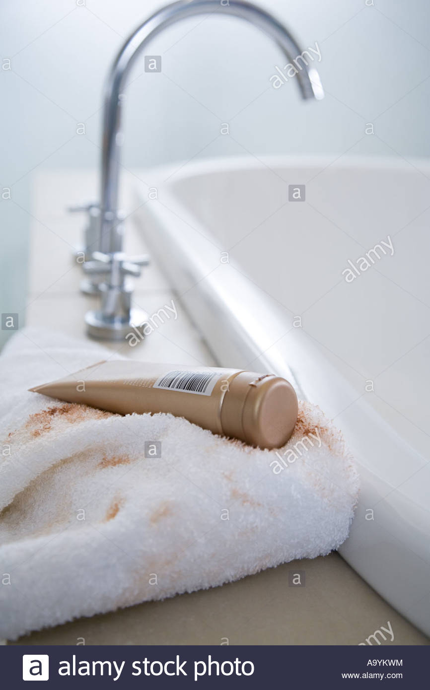 Towel covered in fake tan - Stock Image
