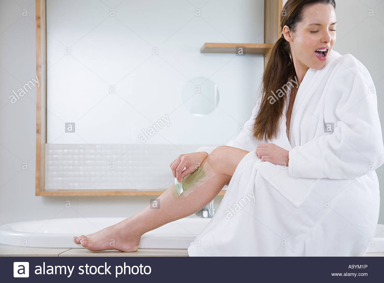 Woman waxing leg - Stock Image
