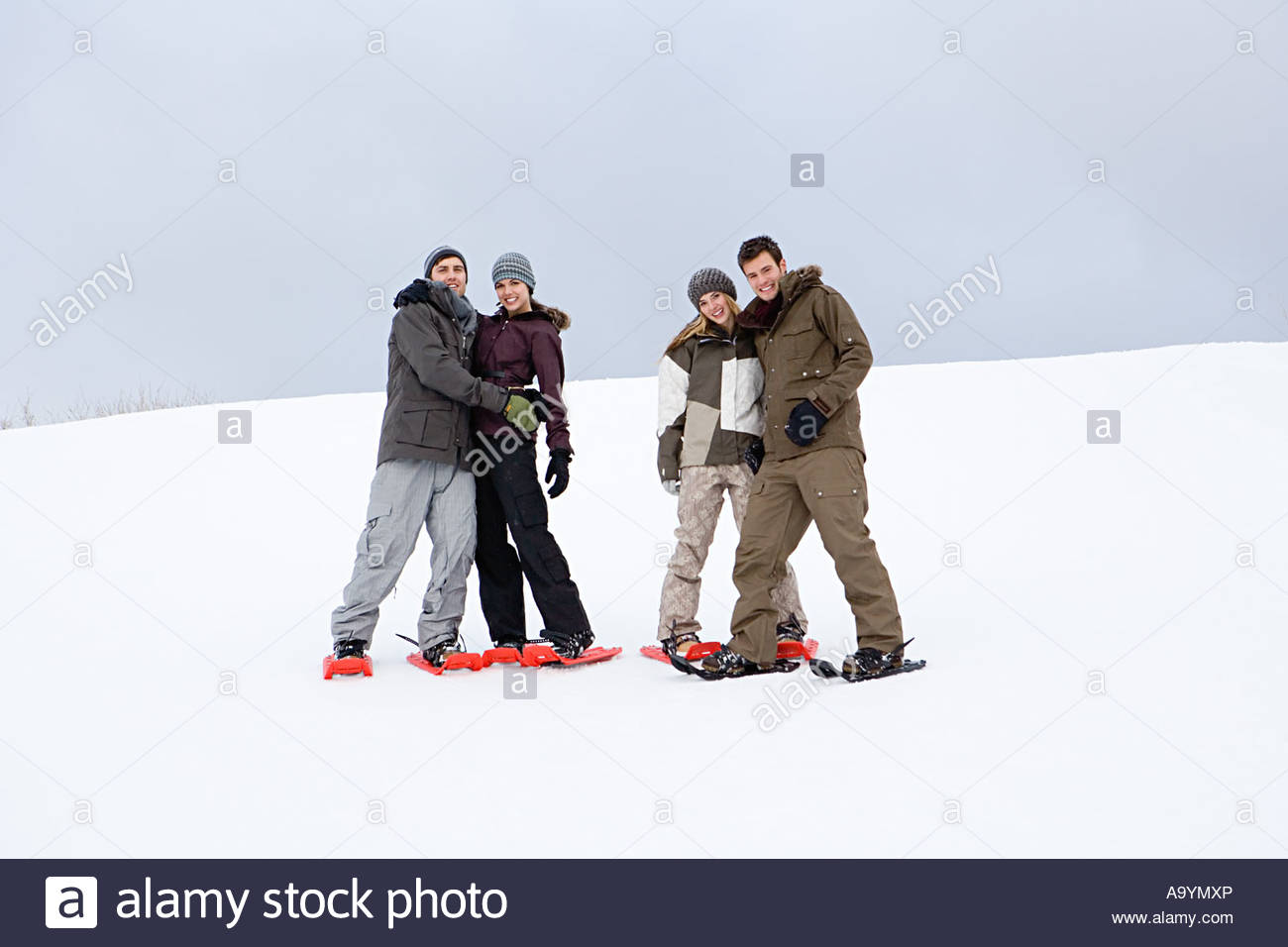 Couples in snowshoes - Stock Image
