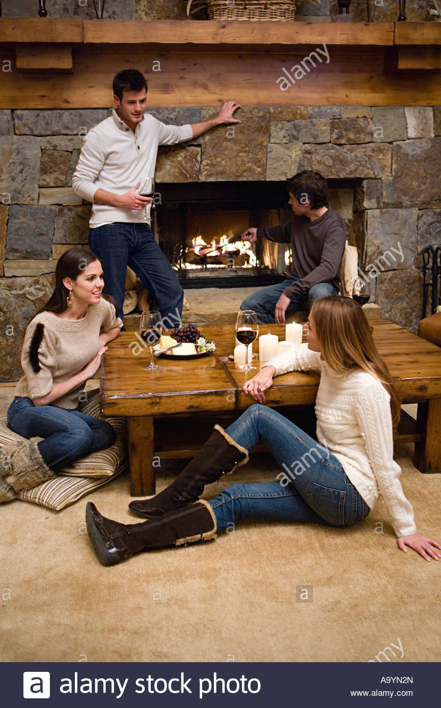 Friends relaxing in a chalet - Stock Image