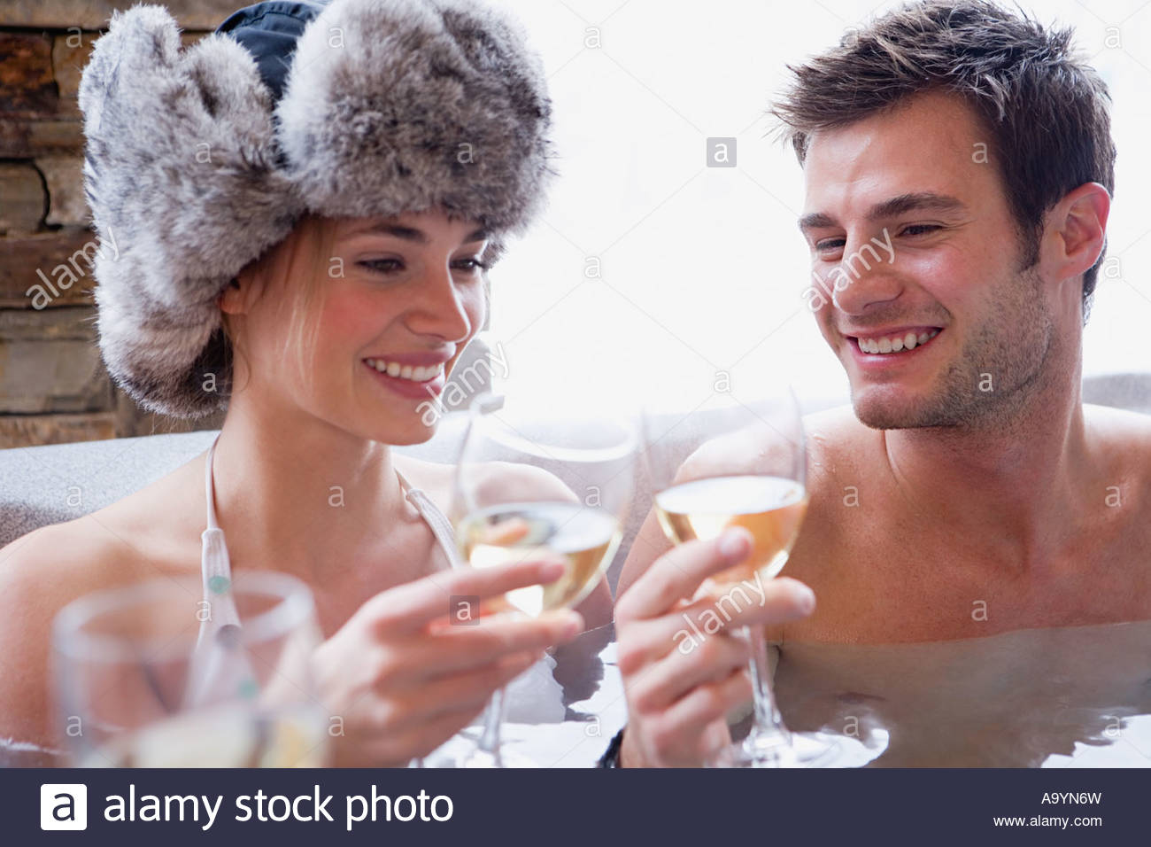 Couple in hot tub with wine - Stock Image