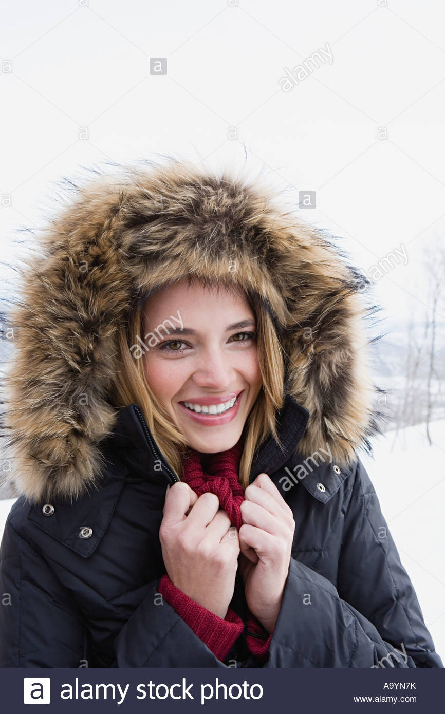 Young woman in a fur hood - Stock Image