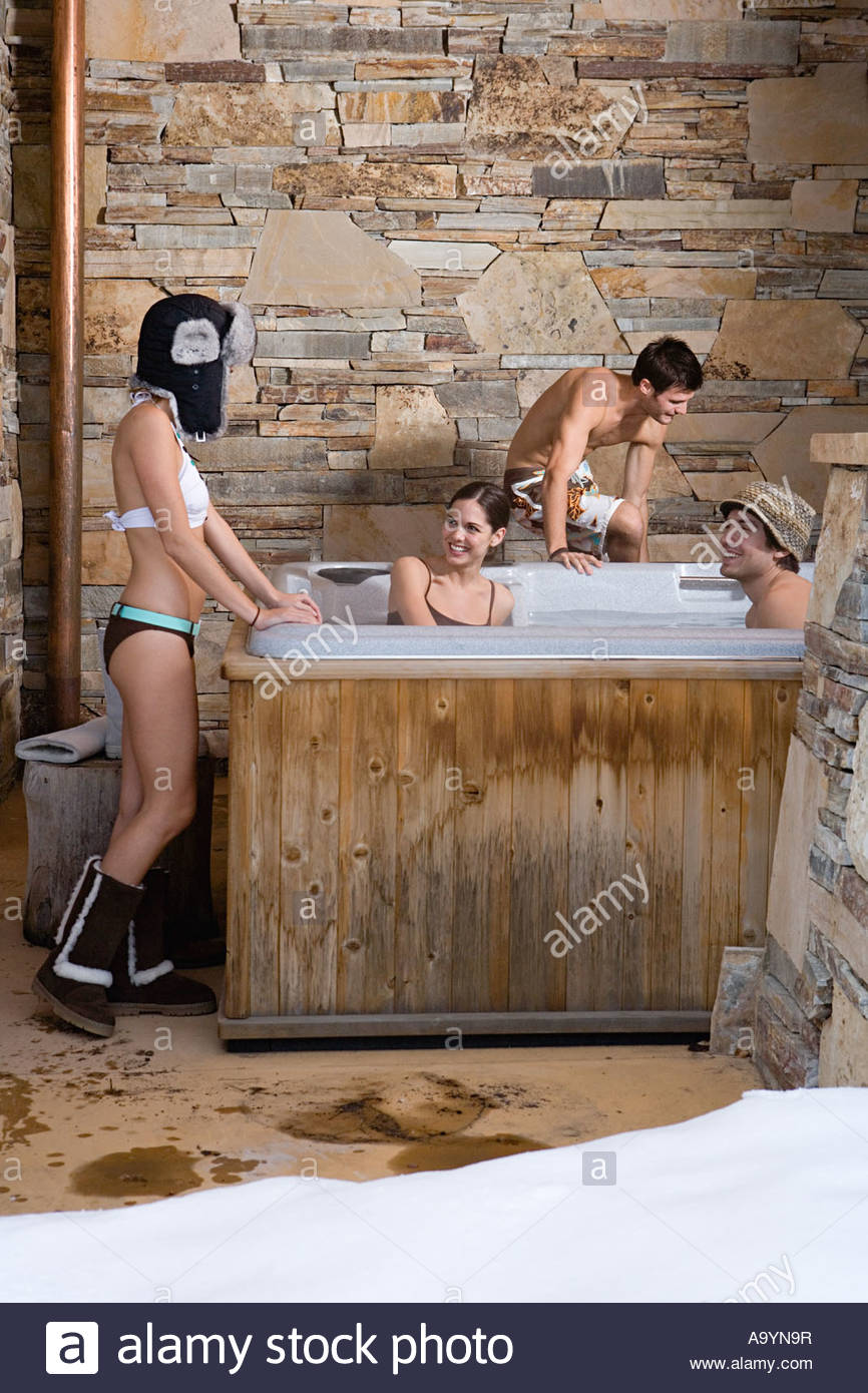 Young people in a hot tub - Stock Image