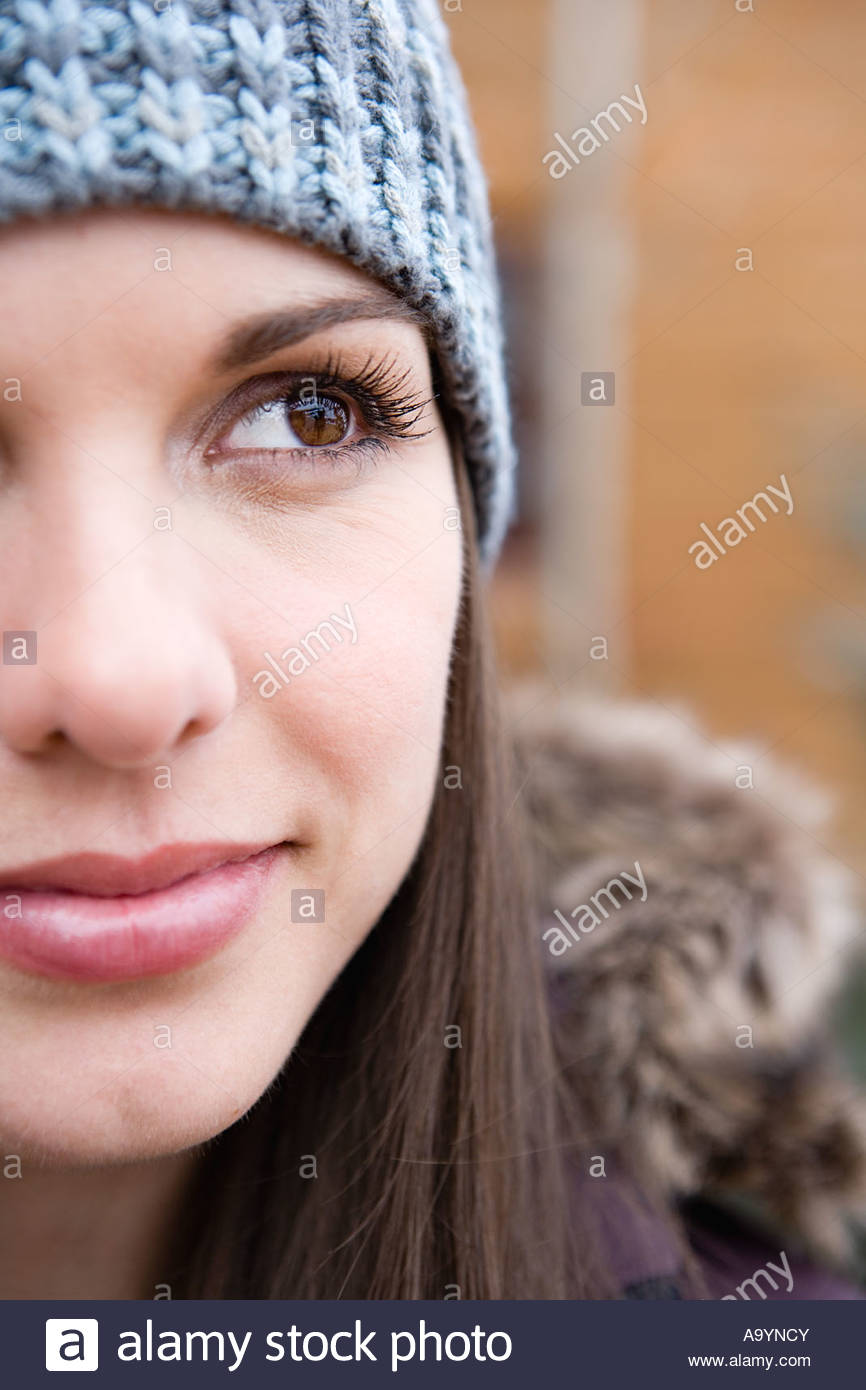 Young woman in a knit hat - Stock Image