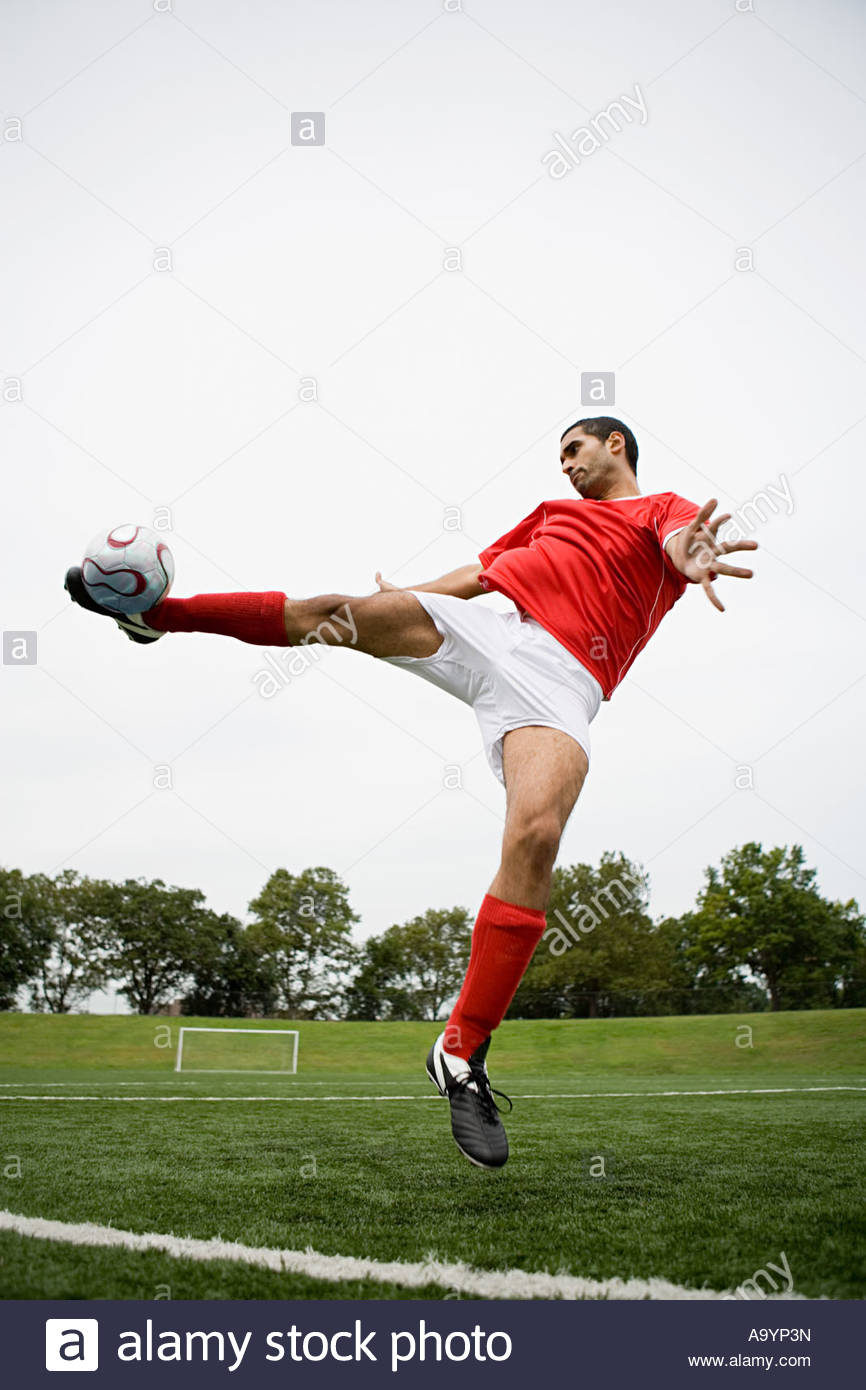 Man playing football - Stock Image