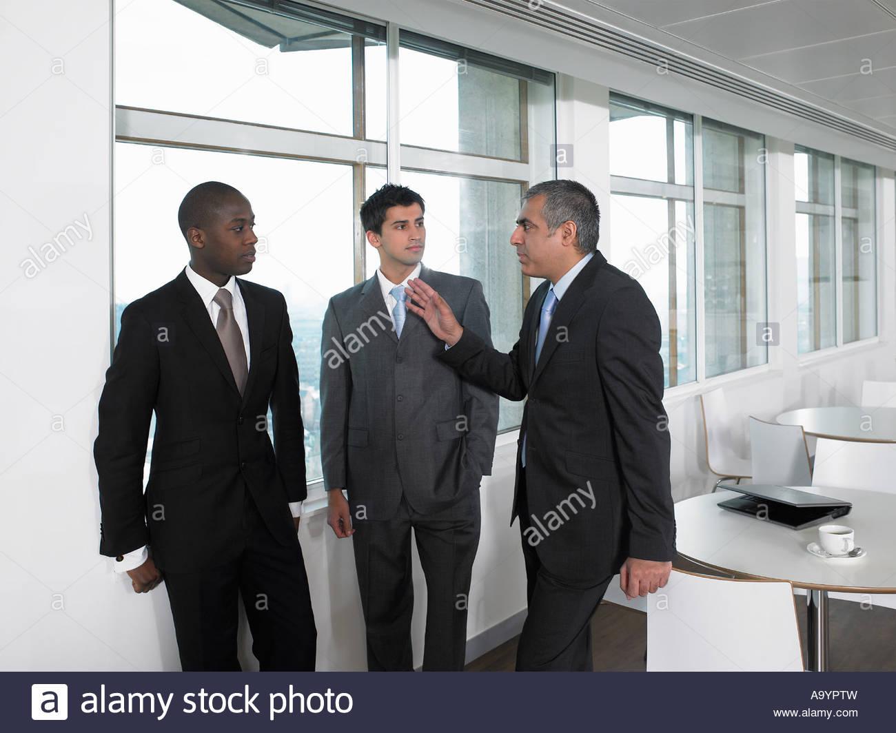 Businessmen having discussion - Stock Image