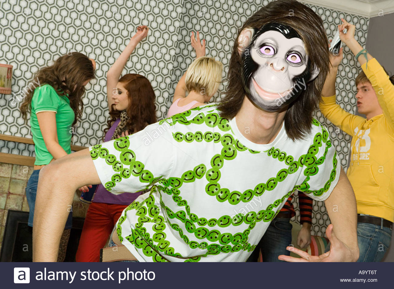 People dancing at a house party - Stock Image