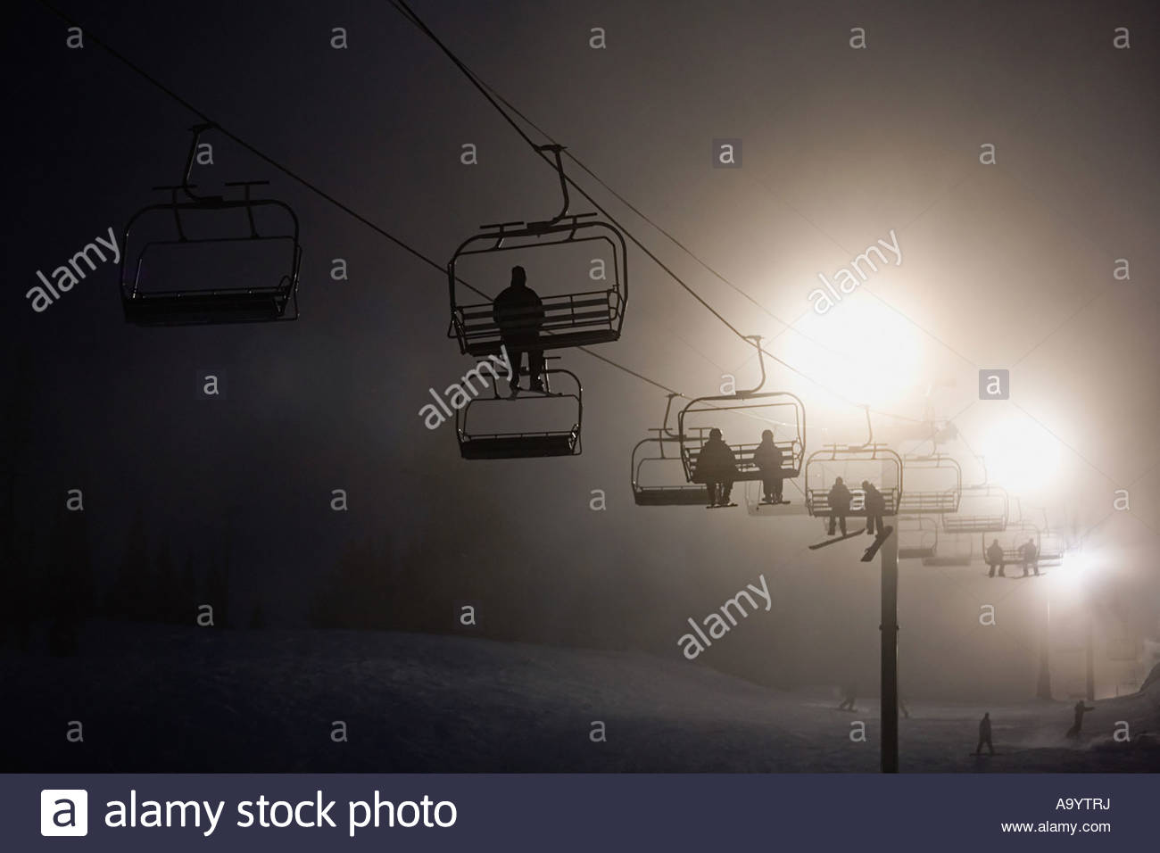 Skiers on a ski lifts - Stock Image