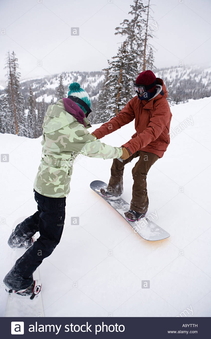 Snowboarder and instructor - Stock Image