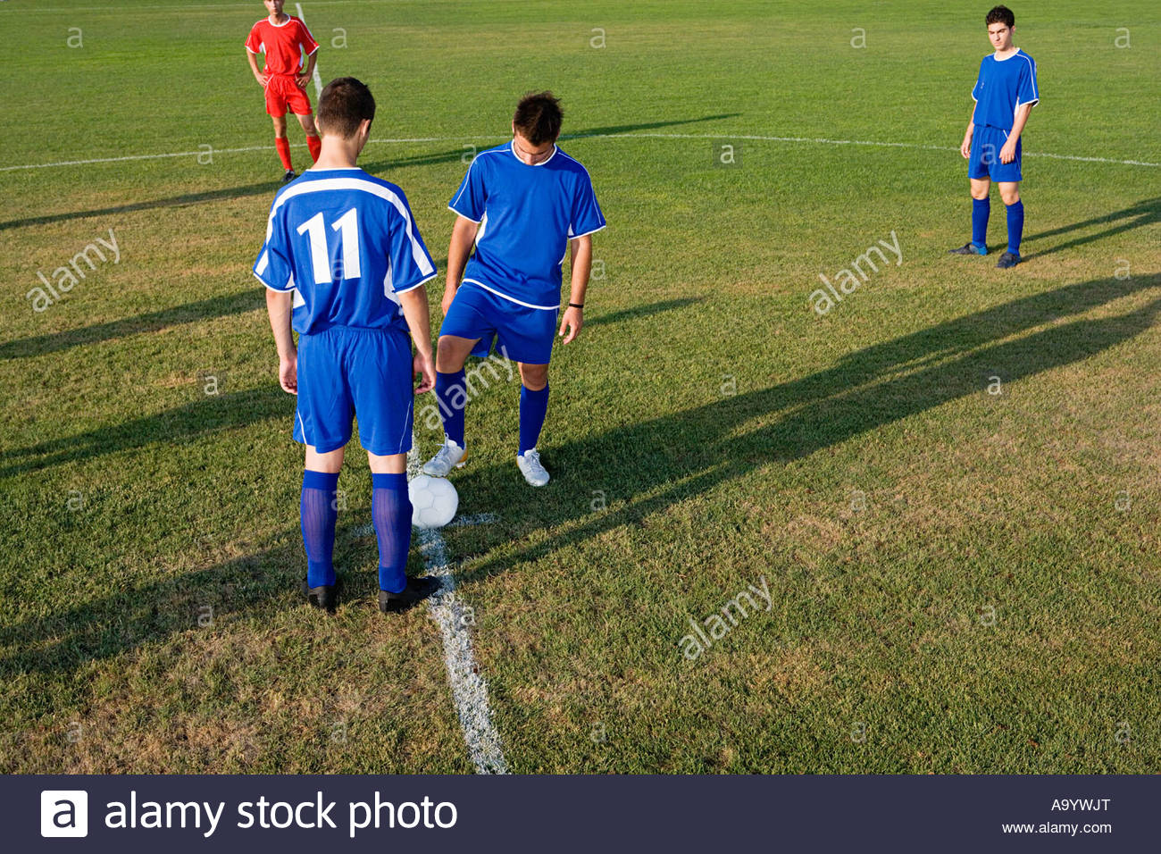 Footballers at beginning of game - Stock Image