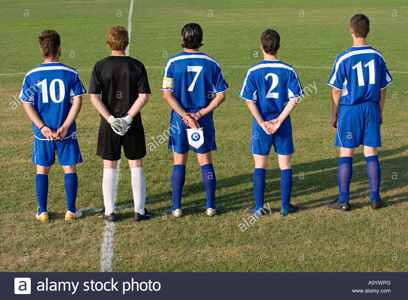 Football team in a row - Stock Image