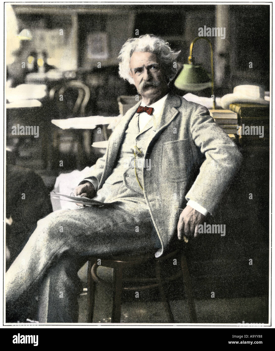 Samuel Clemens Mark Twain in New York visiting his publishers 1900s. Hand-colored halftone of a photograph - Stock Image