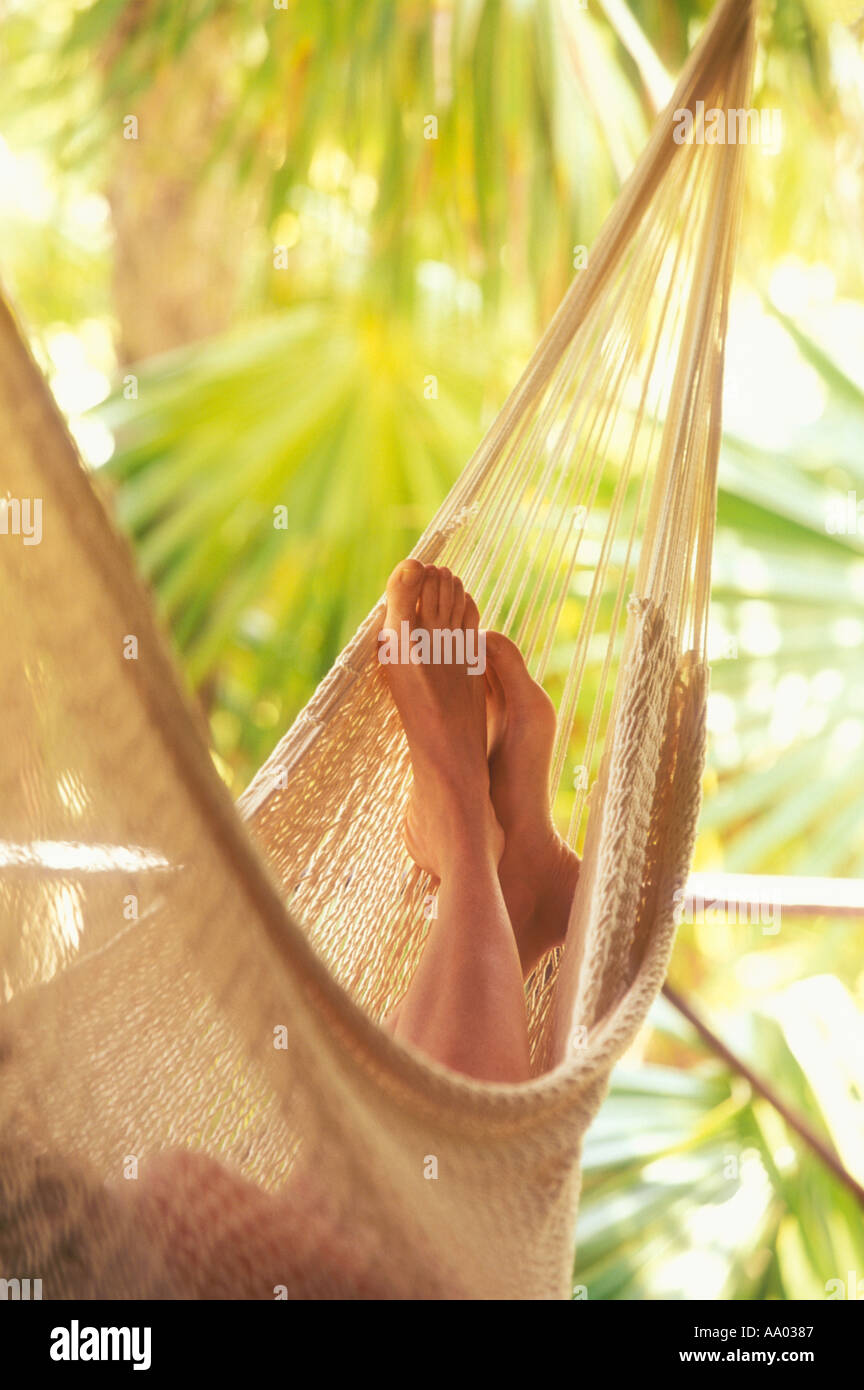 Close up of womans feet in hammock Tulum Quintana Roo Mexico model released image - Stock Image