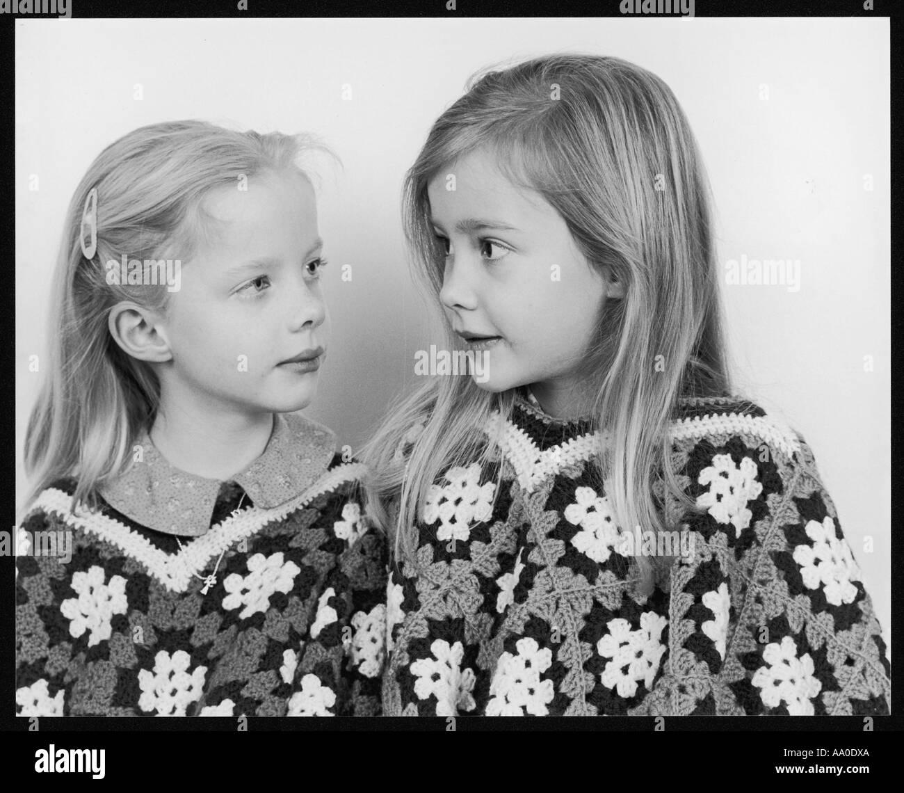 Girls Wearing Ponchos - Stock Image