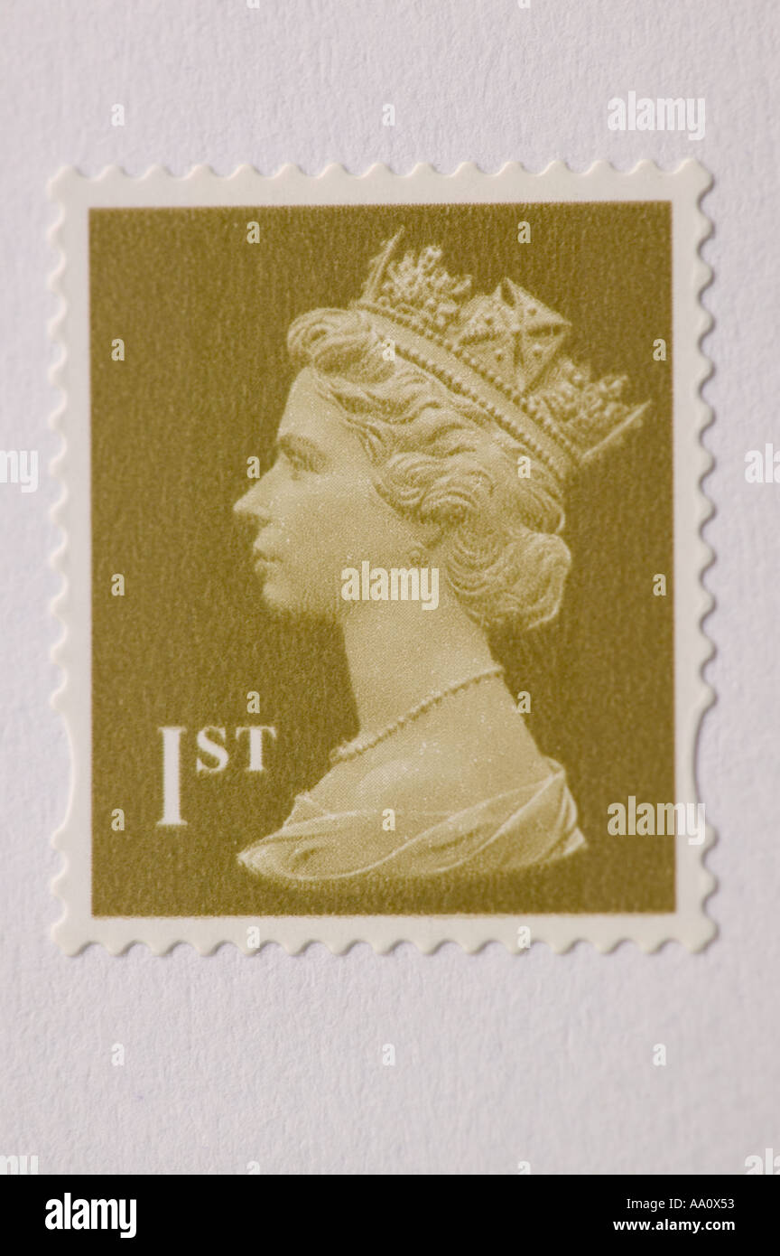 a 1st class stamp on an envelope - Stock Image